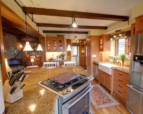 example of a mountain style kitchen design in columbus with glass front cabinets stainless - Lighting Over Kitchen Sink