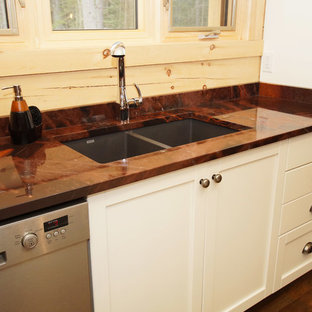 Mid-sized country l-shaped eat-in kitchen in Other with an undermount sink, shaker cabinets, white cabinets, granite benchtops, brown splashback, timber splashback, stainless steel appliances, medium hardwood floors, with island, brown floor and orange benchtop.