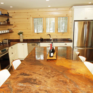 Photo of a mid-sized country l-shaped eat-in kitchen in Other with an undermount sink, shaker cabinets, white cabinets, granite benchtops, brown splashback, timber splashback, stainless steel appliances, medium hardwood floors, with island, brown floor and orange benchtop.