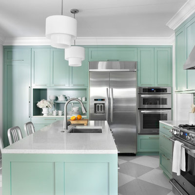 Example of a trendy multicolored floor kitchen design in Atlanta with stainless steel appliances and blue cabinets