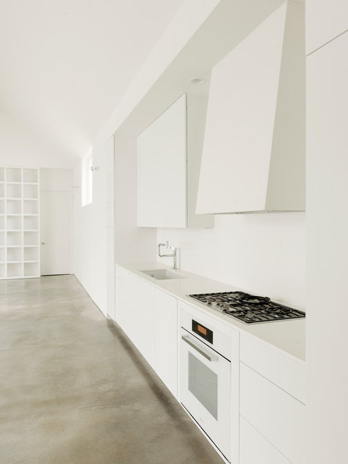 Superbe Example Of A Mid Sized Trendy Single Wall Concrete Floor Open Concept  Kitchen Design