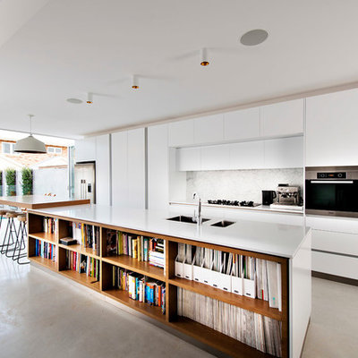 Inspiration for a contemporary galley kitchen remodel in Perth with white cabinets, stone slab backsplash, stainless steel appliances, an island, an undermount sink, flat-panel cabinets and quartz countertops