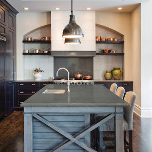 Transitional kitchen in Baltimore with quartzite benchtops, white splashback, dark hardwood floors, with island, an undermount sink and open cabinets.