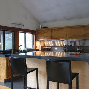 Photo of a contemporary l-shaped kitchen in Boston with medium wood cabinets and metallic splashback.