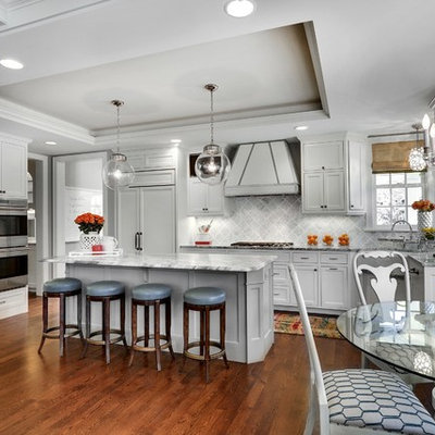 Inspiration for a transitional eat-in kitchen remodel in Minneapolis with recessed-panel cabinets, white cabinets, gray backsplash and white appliances