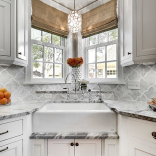 Transitional kitchen designs - Example of a transitional kitchen design in Minneapolis with a farmhouse sink, recessed-panel cabinets, white cabinets, gray backsplash and marble backsplash