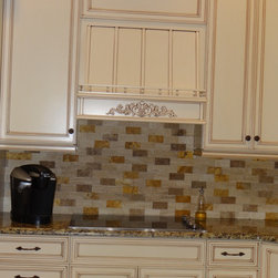Country Elegance - A wood hood over a cooktop.  This one is dressed up with planking, spindle rails and an applique.
