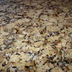 Country Elegance - Granite countertops have come to be a very reasonably priced type of top.  This Santa Cecelia Amber is a great option in color and price.