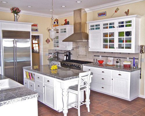 country kitchen pantry with stainless steel appliances