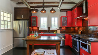 Country house with a modern kitchen and tobacco barn inspired screened porch.
