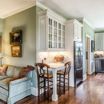 Example of a classic kitchen design in Bridgeport with a farmhouse sink, raised-panel cabinets, white cabinets and stainless steel appliances