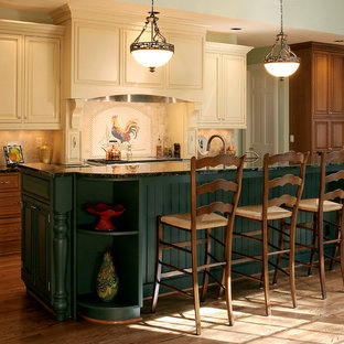Rustic kitchen photos - Example of a mountain style kitchen design in Portland with raised-panel cabinets, beige cabinets and beige backsplash