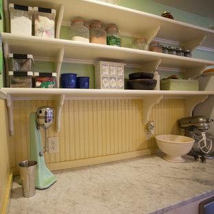 Mid-sized country l-shaped separate kitchen in Seattle with a farmhouse sink, flat-panel cabinets, white cabinets, wood benchtops, with island, beige splashback, timber splashback, stainless steel appliances, vinyl floors, multi-coloured floor and brown benchtop.
