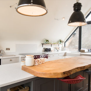 Inspiration for a country l-shaped kitchen/diner in Buckinghamshire with a belfast sink, shaker cabinets, grey cabinets, wood worktops, coloured appliances and an island.