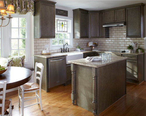 example of a classic eat in kitchen design with subway tile backsplash a farmhouse