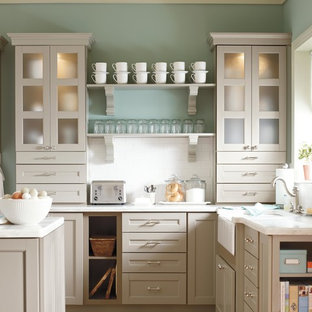 Small farmhouse eat-in kitchen designs - Eat-in kitchen - small farmhouse l-shaped eat-in kitchen idea in New York with shaker cabinets, gray cabinets, solid surface countertops, white backsplash, subway tile backsplash and an island