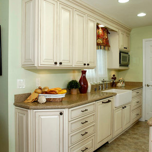 Inspiration for a country u-shaped eat-in kitchen in Sacramento with an integrated sink, raised-panel cabinets, white cabinets, quartzite benchtops, beige splashback, stone slab splashback, panelled appliances and no island.