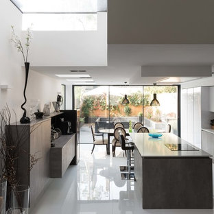 Medium sized contemporary single-wall kitchen/diner in London with porcelain flooring, an island, white floors, flat-panel cabinets and grey cabinets.