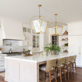 Large coastal eat-in kitchen designs - Large beach style l-shaped medium tone wood floor eat-in kitchen photo in Salt Lake City with white cabinets, marble countertops, multicolored backsplash, marble backsplash, an island and multicolored countertops