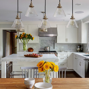 Inspiration for a mid-sized transitional u-shaped eat-in kitchen in Chicago with shaker cabinets, white cabinets, marble benchtops, with island, a single-bowl sink, white splashback, stainless steel appliances, medium hardwood floors and subway tile splashback.
