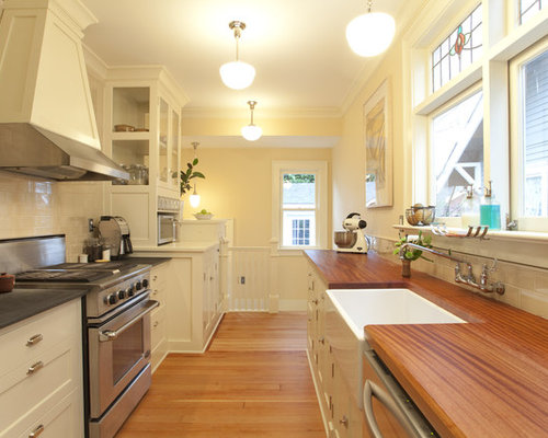 Example Of An Arts And Crafts Galley Enclosed Kitchen Design In Portland  With Shaker Cabinets,