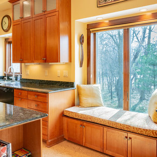 Photo of a large arts and crafts kitchen in Detroit with medium wood cabinets and cork floors.