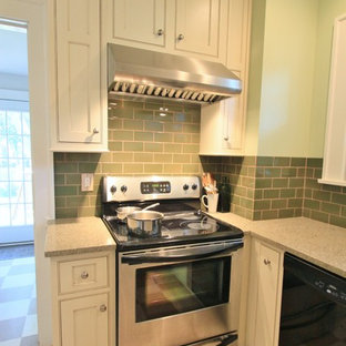 Photo of a small arts and crafts u-shaped separate kitchen in Other with a single-bowl sink, beaded inset cabinets, white cabinets, green splashback, stainless steel appliances, linoleum floors, no island and recycled glass benchtops.