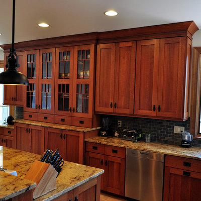 Example of a huge arts and crafts u-shaped ceramic tile eat-in kitchen design in Other with an undermount sink, shaker cabinets, medium tone wood cabinets, granite countertops, multicolored backsplash, stone tile backsplash, stainless steel appliances and an island
