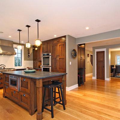 Example of a minimalist medium tone wood floor kitchen design in Chicago