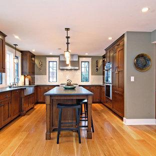 Elegant medium tone wood floor kitchen photo in Chicago