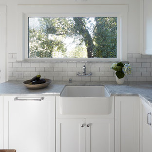 Design ideas for an expansive arts and crafts l-shaped kitchen in San Francisco with a drop-in sink, white cabinets, marble benchtops, white splashback, stainless steel appliances and with island.