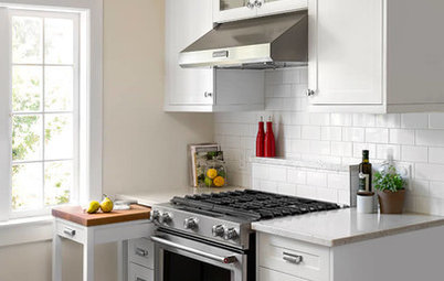 A Pullout Countertop Adds Function to a 90-Square-Foot Kitchen