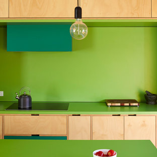 Design ideas for a modern kitchen in Adelaide with green splashback, black appliances and an island.