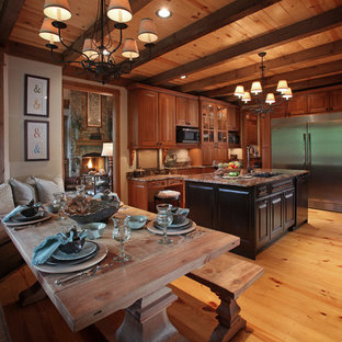 Example of a large classic u-shaped eat-in kitchen design in Atlanta with stainless steel appliances, an undermount sink, raised-panel cabinets, medium tone wood cabinets, granite countertops, beige backsplash and an island