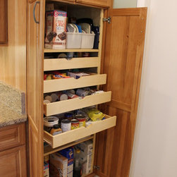 Creative Cabinet Features - Pantry with roll out trays.