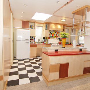 Photo of a mid-sized modern u-shaped eat-in kitchen in San Francisco with a double-bowl sink, flat-panel cabinets, light wood cabinets, recycled glass benchtops, blue splashback, cement tile splashback, white appliances, linoleum floors and a peninsula.