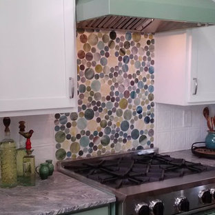 Photo of a mid-sized country separate kitchen in Minneapolis with an undermount sink, shaker cabinets, green cabinets, granite benchtops, multi-coloured splashback, glass tile splashback, coloured appliances, medium hardwood floors and a peninsula.