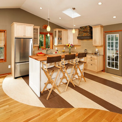 Open concept kitchen - small craftsman l-shaped linoleum floor open concept kitchen idea in DC Metro with an undermount sink, shaker cabinets, light wood cabinets, granite countertops, beige backsplash, glass tile backsplash, stainless steel appliances and an island