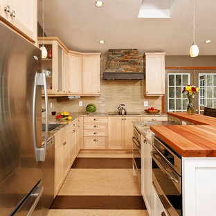 Inspiration for a small arts and crafts l-shaped open plan kitchen in DC Metro with an undermount sink, shaker cabinets, light wood cabinets, granite benchtops, beige splashback, glass tile splashback, stainless steel appliances, linoleum floors and with island.
