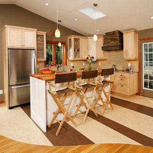 Inspiration for a small classic l-shaped open plan kitchen in DC Metro with a submerged sink, shaker cabinets, light wood cabinets, granite worktops, beige splashback, glass tiled splashback, stainless steel appliances, lino flooring and an island.