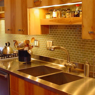 Photo of a mid-sized contemporary l-shaped separate kitchen in Other with an integrated sink, flat-panel cabinets, medium wood cabinets, stainless steel benchtops, green splashback, mosaic tile splashback, stainless steel appliances, dark hardwood floors, no island and brown floor.