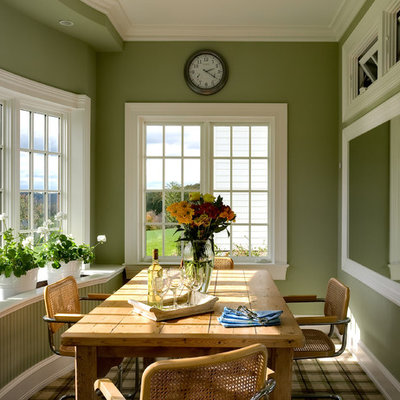 Eat-in kitchen - traditional eat-in kitchen idea in New York with an undermount sink, glass-front cabinets, white cabinets, wood countertops, white backsplash and white appliances