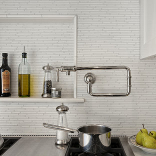 Traditional eat-in kitchen pictures - Eat-in kitchen - traditional eat-in kitchen idea in New York with a farmhouse sink, shaker cabinets, white cabinets, marble countertops, white backsplash and stainless steel appliances