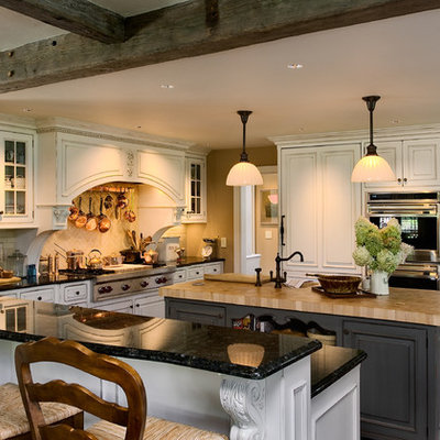 Elegant l-shaped eat-in kitchen photo in New York with white cabinets, granite countertops, paneled appliances, an undermount sink, beaded inset cabinets, white backsplash and subway tile backsplash