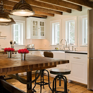 Farmhouse eat-in kitchen pictures - Eat-in kitchen - cottage eat-in kitchen idea in New York with a farmhouse sink, recessed-panel cabinets, white cabinets, white backsplash, subway tile backsplash, soapstone countertops and stainless steel appliances