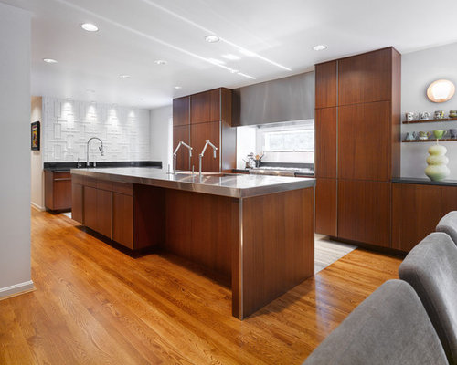 Example Of A Minimalist L Shaped Eat In Kitchen Design In Cincinnati With  Stainless