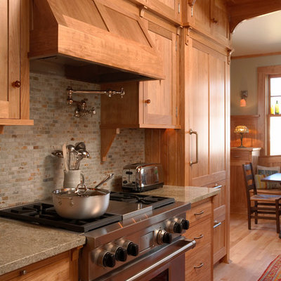 Inspiration for a craftsman medium tone wood floor eat-in kitchen remodel in Minneapolis with recessed-panel cabinets, light wood cabinets, gray backsplash, stainless steel appliances, no island, granite countertops, a farmhouse sink and slate backsplash