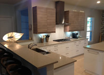 What is the material of the white lower cabinets?