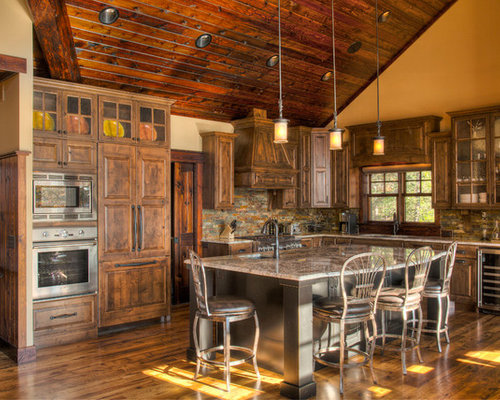 example of a mountain style kitchen design in minneapolis with an undermount sink raised - Rustic Style Kitchen Designs