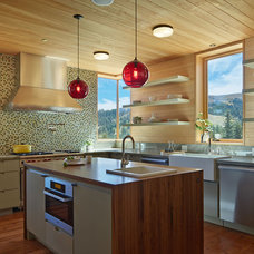 Rustic Kitchen by Mt. Lincoln Construction Inc.